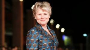 """This Oct. 19, 2019 file photo shows actress Imelda Staunton on the red carpet for the movie """"Downton Abbey"""" at the Rome Film Fest in Rome. (AP Photo/Domenico Stinellis, File)"""