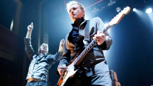In this Feb. 8, 2011, file photo, Gang of Four's guitarist Andy Gill and singer Jon King, left, perform a concert at Webster Hall in New York. Gill, who led the highly influential British post-punk band Gang of Four, died Saturday, Feb. 1, 2020, in London, according to a statement from the band. He was 64. (AP Photo/Jason DeCrow, File)