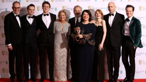 From left, Callum McDougall, Charles Chapman, George Mackay, Jayne-Ann Tenggren, Sam Mendes, Pippa Harris, Krysty Wilson-Cairns, Mark Strong and Andrew Scott, winners of Best Film for 1917, backstage at the Bafta Film Awards, in central London, Sunday, Feb. 2, 2020. (Photo by Joel C Ryan/Invision/AP)