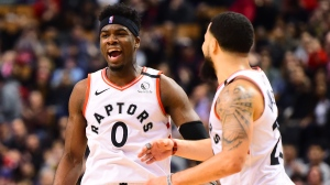 Toronto Raptors guard Terence Davis (0) and teammate Fred VanVleet (23) celebrate a basket during second half NBA basketball action against the Chicago Bulls, in Toronto, Sunday, Feb. 2, 2020. THE CANADIAN PRESS/Frank Gunn