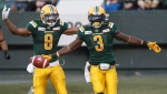 Edmonton Eskimos Kenny Stafford (8) and Natey Adjei (3) celebrate a touchdown against the B.C. Lions during first half CFL action in Edmonton, Alta., on Friday June 29, 2018. THE CANADIAN PRESS/Jason Franson.