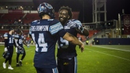 Toronto Argonauts quarterback McLeod Bethel-Thompson (14) embraces Toronto Argonauts wide receiver S.J. Green (19) after full time of CFL action against the Ottawa Redblacks in Toronto on Thursday, August, 2, 2018. THE CANADIAN PRESS/Christopher Katsarov
