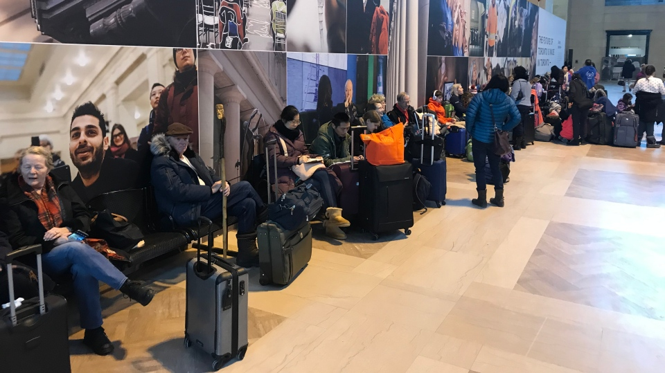 Passengers wait to try and catch a train at Union Station in downtown Toronto Friday, February 7, 2020. (John Musselman /CTV News Toronto)