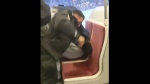 TTC staff subdue a rider in a violent altercation caught on video. (@CascadingDesign /Twitter)