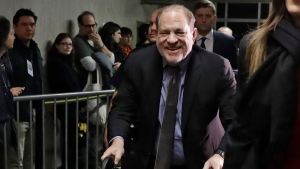 Harvey Weinstein leaves a Manhattan courtroom during his rape trial in New York, Friday, Feb. 7, 2020. (AP Photo/Richard Drew)