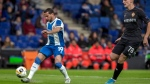 Espanyol's Pablo Piatti, left, kicks the ball during a Europa League soccer match Group H between RCD Espanyol and CSKA Moscow at the RCDE stadium in Barcelona, Spain, Thursday, Dec. 12, 2019. (AP Photo/Joan Monfort)