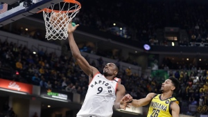 Toronto Raptors' Serge Ibaka (9) shoots against Indiana Pacers' Jeremy Lamb (26) during the first half of an NBA basketball game, Friday, Feb. 7, 2020, in Indianapolis. (AP Photo/Darron Cummings)