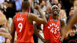 Toronto Raptors centre Serge Ibaka (9) and teammate Pascal Siakam (43) celebrate their win following second half NBA basketball action against the Brooklyn Nets, in Toronto, Saturday, Feb. 8, 2020. THE CANADIAN PRESS/Frank Gunn