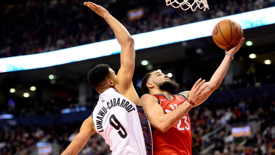 Toronto Raptors guard Fred VanVleet (23) goes for the lay up as Brooklyn Nets guard Timothe Luwawu-Cabarrot (9) defends during second half NBA basketball action in Toronto, Saturday, Feb. 8, 2020. THE CANADIAN PRESS/Frank Gunn