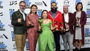 "From left, Peter Saraf, Daniele Melia, Lulu Wang, Andrew Miano, Eddie Rubin, Anita Gou pose in the press room with the award for best feature for ""The Farewell"" at the 35th Film Independent Spirit Awards on Saturday, Feb. 8, 2020, in Santa Monica, Calif. (Photo by Richard Shotwell/Invision/AP)"