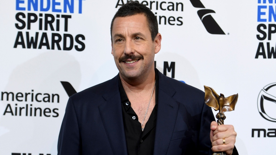 "Adam Sandler poses in the press room with the award for best male lead for ""Uncut Gems at the 35th Film Independent Spirit Awards on Saturday, Feb. 8, 2020, in Santa Monica, Calif. (Photo by Richard Shotwell/Invision/AP)"