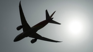 A plane is silhouetted as it takes off from Vancouver International Airport in Richmond, B.C., Monday, May 13, 2019. Families who have endured anxiety-inducing airport delays over no-fly list mismatches will be among the first to test a new system intended to solve the problem. THE CANADIAN PRESS/Jonathan Hayward