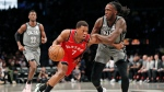 Toronto Raptors guard Kyle Lowry (7) drives around Brooklyn Nets forward Taurean Prince (2) as Brooklyn Nets guard Caris LeVert (22) looks on during the first quarter of an NBA basketball game, Wednesday, Feb. 12, 2020, in New York. (AP Photo/Kathy Willens)