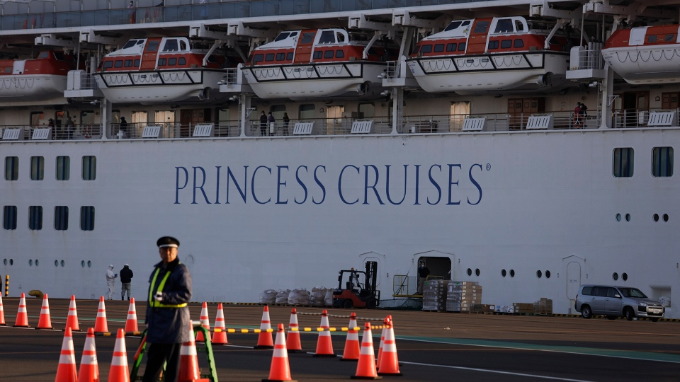 Princess cruise ship Thursday, Feb. 13, 2020, in Yokohama, near Tokyo. Life on board the luxury cruise ship, which has dozens of cases of a new virus, can include fear, excitement and soul-crushing boredom, according to interviews by The Associated Press with passengers and a stream of tweets and YouTube videos. (AP Photo/Jae C. Hong)