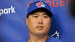Toronto Blue Jays pitcher Hyun-Jin Ryu talks to the media after workouts at the teamÕs spring training facilities Thursday, Feb. 13, 2020, in Dunedin, Fla. THE CANADIAN PRESS/Steve Nesius