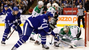 Toronto Maple Leafs centre Auston Matthews (34) tries to get to the puck as Dallas Stars goaltender Ben Bishop (30) gets his glove on it during second period NHL hockey action in Toronto, Thursday, Feb. 13, 2020. THE CANADIAN PRESS/Frank Gunn