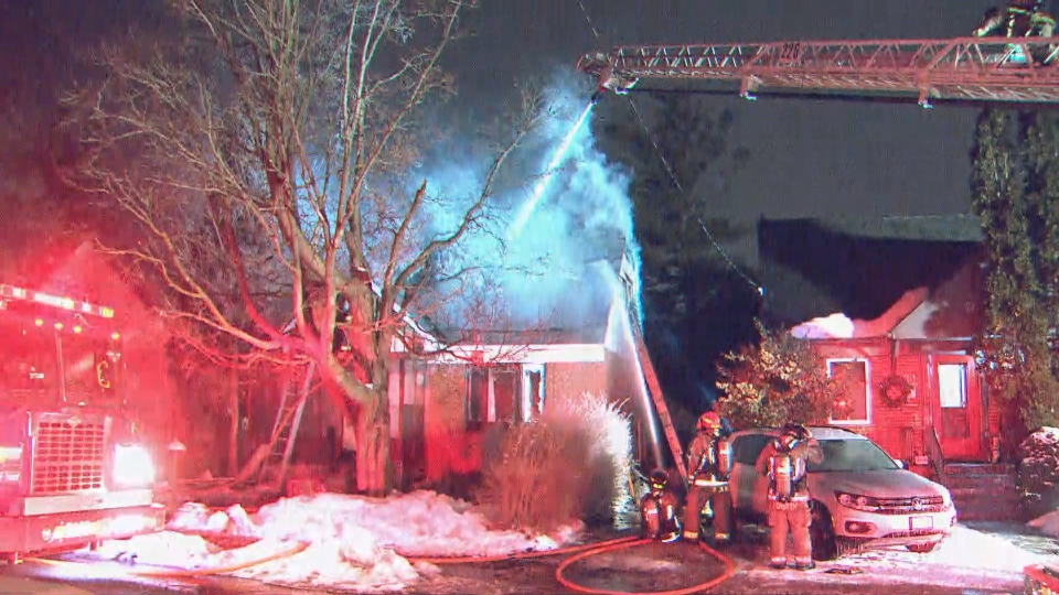 Firefighters are battling a house fire near Danforth Road and Warden Avenue.