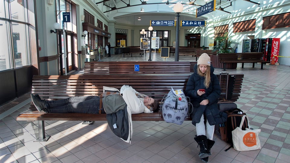 Australians Rebecca Bolton, right, and Dillon Hamill wait for a bus at the Via Rail station in Halifax on Friday, February 14, 2020. The couple, heading to Quebec by train, had their travel plans skewered as rail service across the country has been disrupted by protests related to the construction of a natural gas pipeline in British Columbia. THE CANADIAN PRESS/Andrew Vaughan