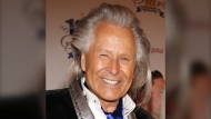 Peter Nygard arrives at the 24th Night of 100 Stars Oscars Viewing Gala at The Beverly Hills Hotel in Beverly Hills, Calif., on March 2, 2014. (THE CANADIAN PRESS/AP, Invision - Annie I. Bang)
