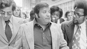 In this Sept. 4, 1975 file photo, Charles O'Brien, Jimmy Hoffa's adopted son, leaves the federal court building in Detroit. O'Brien, a longtime associate of the late Jimmy Hoffa who became a leading suspect in the Teamsters boss' disappearance, has died. O'Brien's stepson, Harvard Law School professor Jack Goldsmith, said in a blog post that O'Brien died Thursday, Feb. 13m 2020 in Boca Raton, Fla., from what appeared to be a heart attack. (AP Photo/Richard Sheinwald, File)