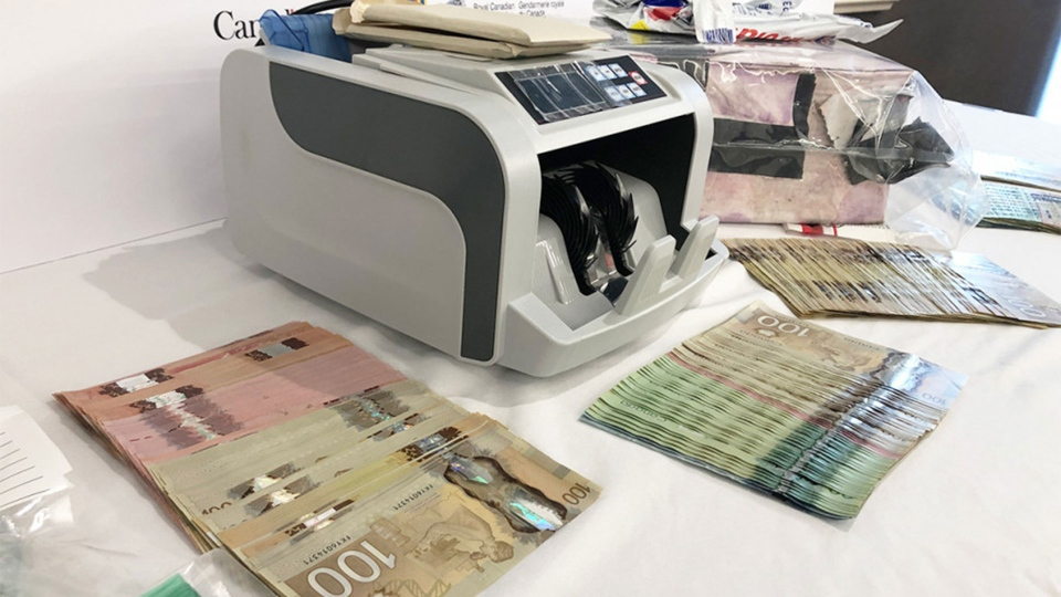 Cash, a money counter, jewellery and packaged envelopes are among the items seized by the RCMP through Project Octavia, investigation into the CRA phone scam targeting Canadians. (RCMP /Handout)