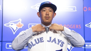 Shun Yamaguchi is feeling like a rookie again as he begins his first spring training in the major leagues. Toronto Blue Jays newly-signed pitcher Shun Yamaguchi adjusts his shirt before posing for photographers after speaking to the media in Toronto, Wednesday, Jan. 15, 2020. THE CANADIAN PRESS/Chris Young