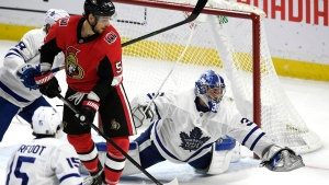 Toronto Maple Leafs goaltender Jack Campbell (36) reaches for the rebounding puck as Ottawa Senators centre Artem Anisimov (51) watches, during second period NHL hockey action in Ottawa, Saturday February 15, 2020. THE CANADIAN PRESS/Justin Tang