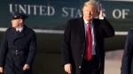 President Donald Trump smoothes his hair as he walks to Air Force One as he departs Friday, Feb. 14, 2020, at Andrews Air Force Base, Md. Trump is going to his Mar-a-Largo resort in Florida. (AP Photo/Alex Brandon)