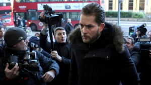 Lewis Burton, partner of Love Island presenter Caroline Flack, arrives at Highbury Magistrates' Court in London, Monday, Dec. 23, 2019. (AP Photo/Petros Karadjias)
