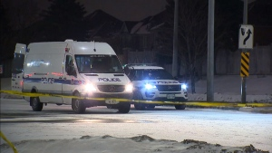 Peel Regional Police cruisers are seen at the scene of a collision on Saturday night in Brampton. (CP24)