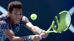 Canada's Felix Auger-Aliassime makes a backhand return to Latvia's Ernests Gulbis during their first round singles match at the Australian Open tennis championship in Melbourne, Australia, Tuesday, Jan. 21, 2020. THE CANADIAN PRESS/AP-Dita Alangkara