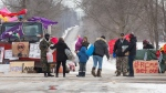 Supporters bring supplies to protesters at a rail blockade on the eleventh day of demonstration in Tyendinaga, near Belleville, Ont., Sunday, Feb. 16, 2020. The protest is in solidarity with the Wet'suwet'en hereditary chiefs opposed to the LNG pipeline in northern British Columbia. THE CANADIAN PRESS/Lars Hagberg