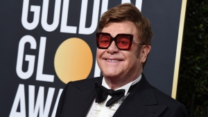 FILE - In this Jan. 5, 2020 file photo, Elton John arrives at the 77th annual Golden Globe Awards at the Beverly Hilton Hotel, in Beverly Hills, Calif. An emotional John had to cut short a performance in New Zealand on Sunday, Feb. 16 after he lost his voice due to walking pneumonia and had to be assisted off stage. (Photo by Jordan Strauss/Invision/AP, File)