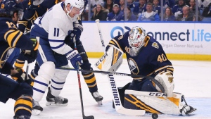 Buffalo Sabres goalie Carter Hutton (40) stops Toronto Maple Leafs forward Zach Hyman (11) during the first period of an NHL hockey game Sunday, Feb. 16, 2020, in Buffalo, N.Y. (AP Photo/Jeffrey T. Barnes)