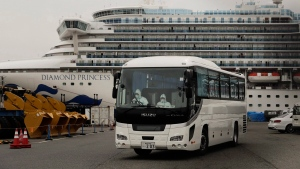 A bus leaves a port where the quarantined Diamond Princess cruise ship is docked Saturday, Feb. 15, 2020, in Yokohama, near Tokyo. The federal government says it will evacuate Canadians quarantined aboard a cruise ship docked in Japan. THE CANADIAN PRESS/AP-Jae C. Hong