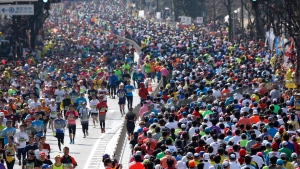 In this Feb. 28, 2016, file photo, runners make their way during the Tokyo Marathon in Tokyo. (AP Photo/Shizuo Kambayashi, File)