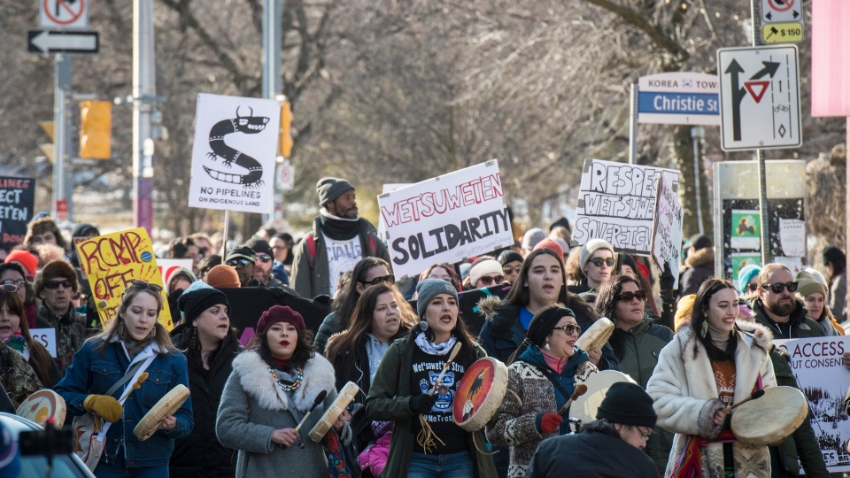 People make their way towards Queen's Park during a Family Day march in support of the Wet'suwet'en hereditary chiefs in Toronto on Monday, February 17, 2020. THE CANADIAN PRESS/ Tijana Martin