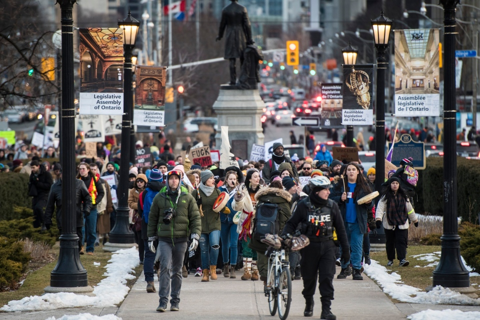 People arrive at Queen's Park during a Family Day march in support of the Wet'suwet'en hereditary chiefs in Toronto on Monday, February 17, 2020. THE CANADIAN PRESS/ Tijana Martin