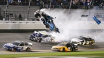 Ryan Newman (6) goes airborne as he collided with Corey LaJoie (32) on the final lap of the NASCAR Daytona 500 auto race at Daytona International Speedway, Monday, Feb. 17, 2020, in Daytona Beach, Fla. Sunday's race was postponed because of rain. (AP Photo/Terry Renna)