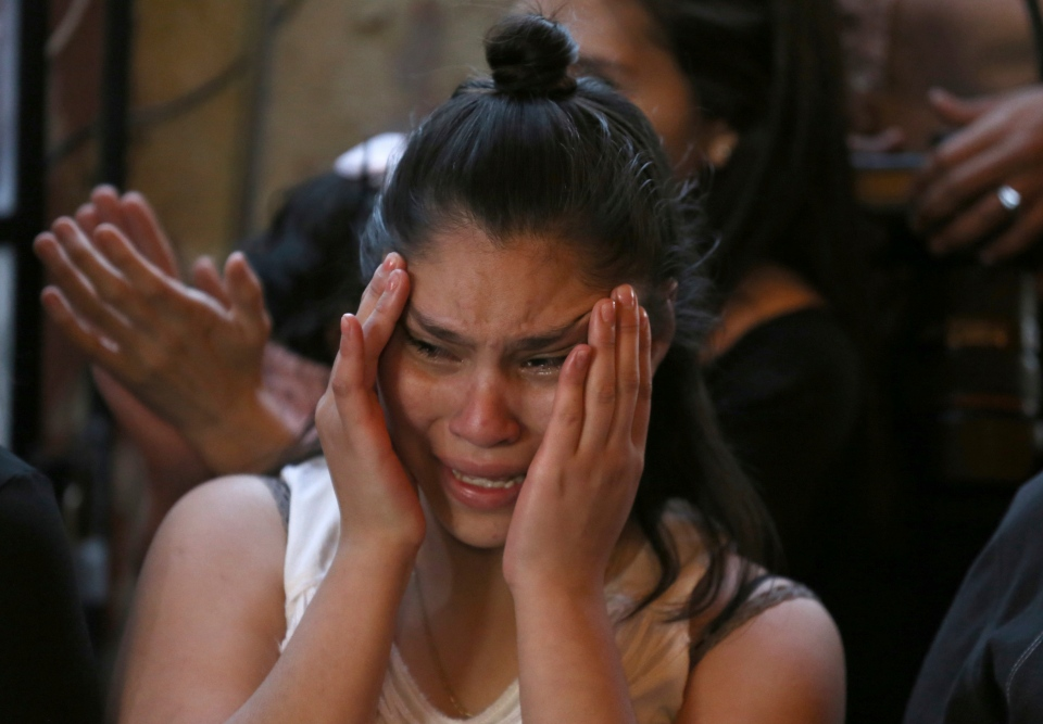 A relative of Fatima, a 7-year-old girl who was abducted from the entrance of the Enrique C. Rebsamen primary school and later killed, cries during Fatima's wake at her home in Mexico City, Monday, Feb. 17, 2020. The girl's body was found wrapped in a bag and abandoned in a rural area on Saturday and was identified by genetic testing. (AP Photo/Marco Ugarte)