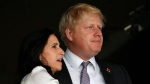 Boris Johnson, right, and Marina Wheeler wait for the start of the Opening Ceremony at the 2012 Summer Olympics, Friday, July 27, 2012, in London. (AP Photo/Jae C. Hong)