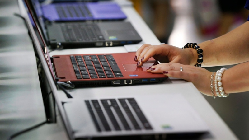 A person uses a laptop in this file photo from June 2, 2015. (AP / Wally Santana)