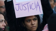 "A woman holds up the Spanish message ""I can't stand it anymore. Justice"" during a protest against gender violence outside the National Palace that includes the presidential office and residence in Mexico City, Tuesday, Feb. 18, 2020. The killing of a 7-year-old girl on the southern outskirts of Mexico City has stoked rising anger over the brutal slayings of women, including one found stabbed to death and skinned earlier this month. (AP Photo/Eduardo Verdugo)"