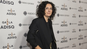 Alexandra Streliski arrives at the Gala Adisq awards ceremony in Montreal on October 27, 2019. Breakout neo-classical pianist Alexandra Streliski will join City and Colour's Dallas Green in a performance at this year's Juno Awards in Saskatoon. Streliski, who hails from Quebec, has become one of the stars to watch on the classical music scene. She's competing for three prizes at Canada's biggest night in music, including album of the year and breakthrough artist, while Green's project is up for adult alternative album of the year. THE CANADIAN PRESS/Graham Hughes
