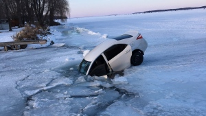 A Toyota is pictured partially submerged in the ice of Cook's Bay in Innisfil Monday February 17, 2020. (@laurazava /Twitter)