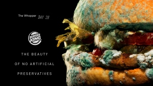 This undated image provided by Burger King shows an advertising campaign image with the Whopper hamburger. The burger chain is showing its Whopper covered in mold in print and TV ads running in Europe and the U.S. The message: Burger King is removing artificial preservatives from the Whopper. (Burger King via AP)