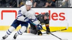 Toronto Maple Leafs left wing Andreas Johnsson skates around Vegas Golden Knights defenseman Nate Schmidt (88) during the third period of an NHL hockey game Tuesday, Nov. 19, 2019, in Las Vegas. THE CANADIAN PRESS/AP, John Locher