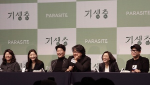 "Bong Joon-ho, director of Oscar-winning ""Parasite,"" center right, speaks during a press conference in Seoul, South Korea, Wednesday, Feb. 19, 2020. (AP Photo/Ahn Young-joon)"
