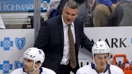 Toronto Maple Leafs coach Sheldon Keefe walks behind his bench during the first period of the team's NHL hockey game against the Pittsburgh Penguins in Pittsburgh, Tuesday, Feb. 18, 2020. The Penguins won 5-2. (AP Photo/Gene J. Puskar)