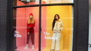 "Women stand behind a Toronto storefront window as part of a campaign launched by Covenant House Toronto called ""Shoppable Girls."" (CTV News Toronto)"